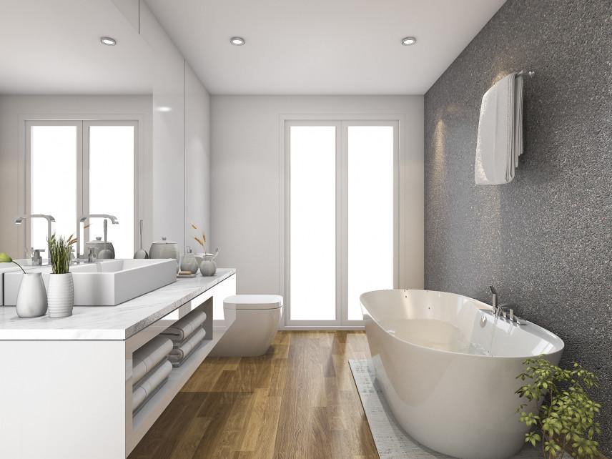 Łazienka z okrągłą wanną i szarą ścianą