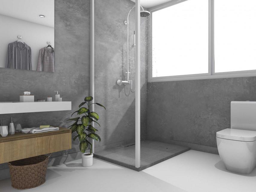 Łazienka z betonową ścianą i prysznicem