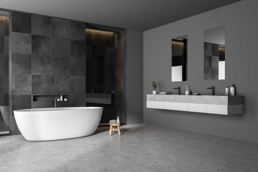 Grafitowa łazienka z betonową podłogą