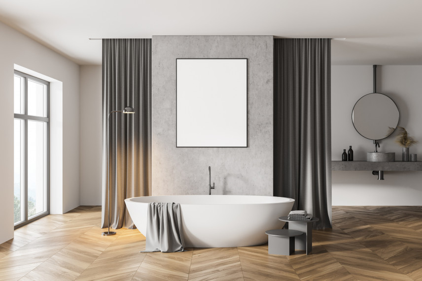 Łazienka z szarą ścianą i parkietem