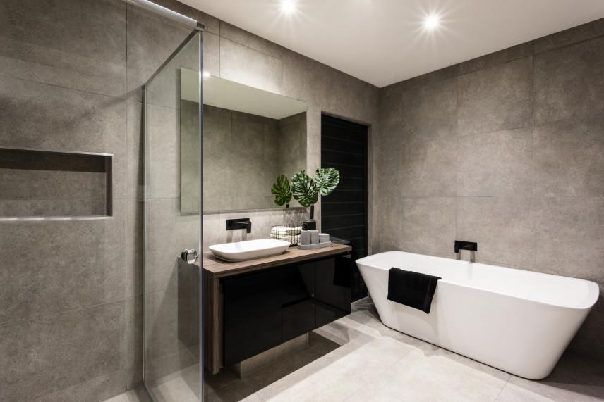 Szara łazienka z betonowymi ścianami
