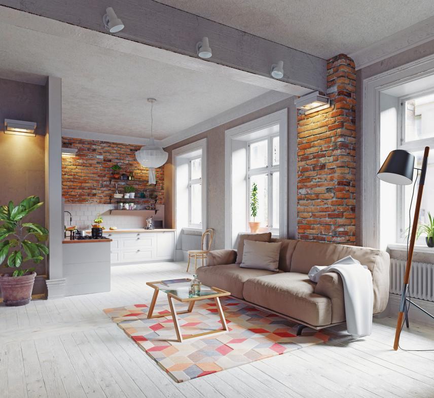 Szary salon z drewnianą podłogą i cegłą na ścianie