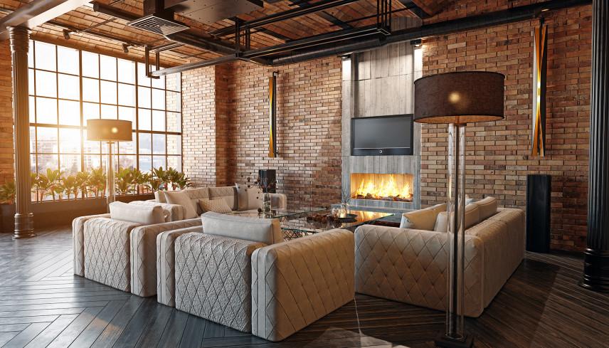 Loftowy salon z pikowanymi fotelami i sofą