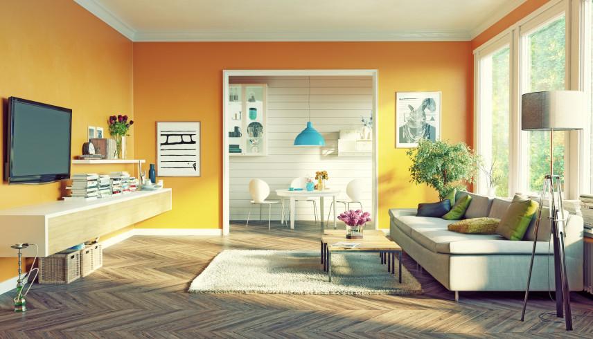 Żółty salon w stylu skandynawskim połączony z kuchnią