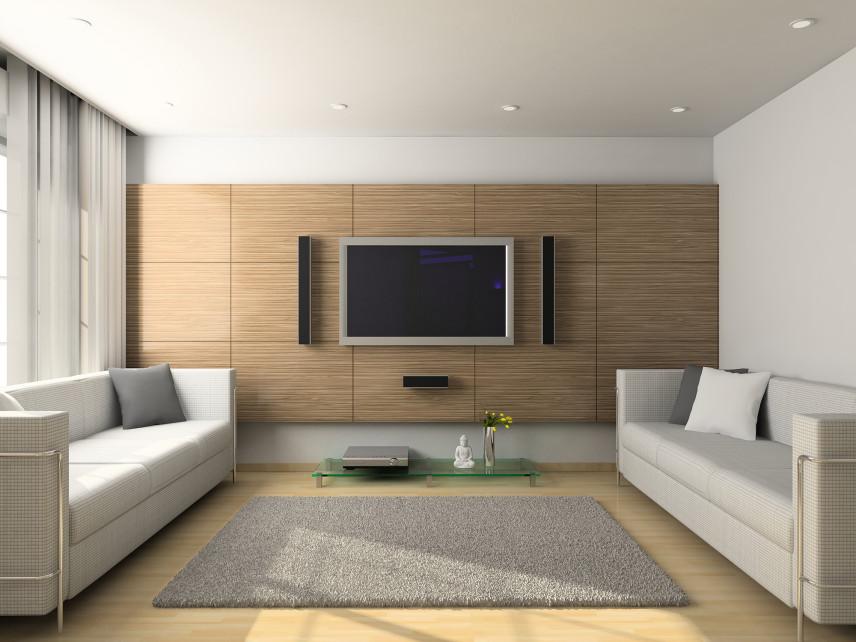 Salon z telewizorem i ścianą imitującą drewno