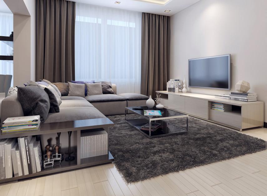 Średniej wielkości salon  z TV na ścianie