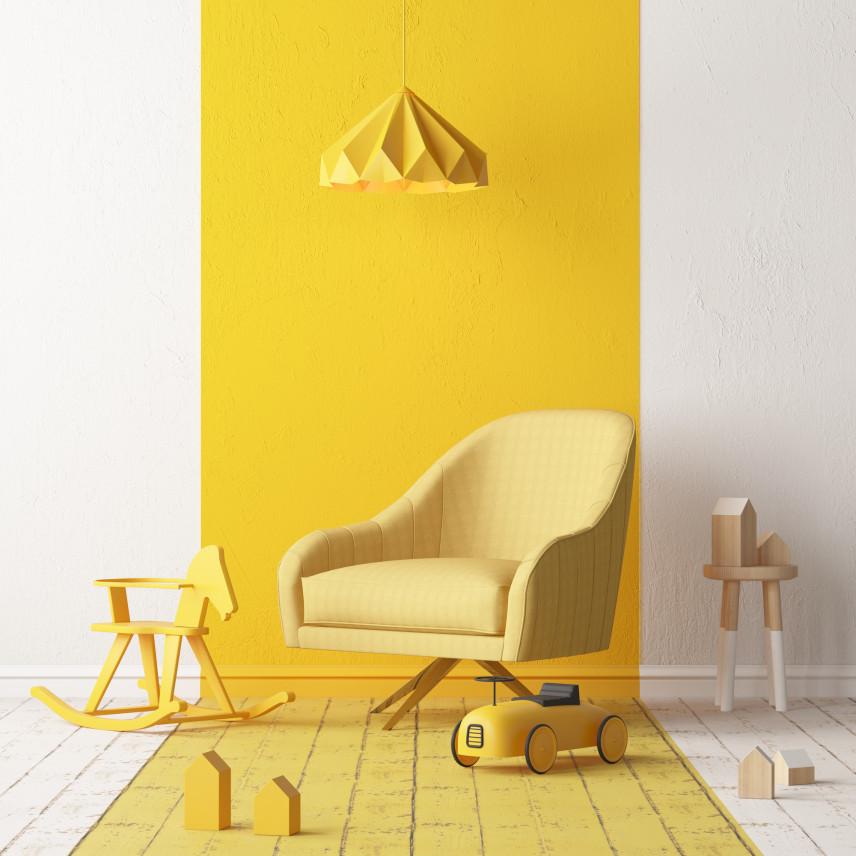 Żółty fotel w pokoju dziecka