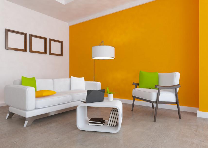 Aranżacja salonu z pomarańczową ścianą