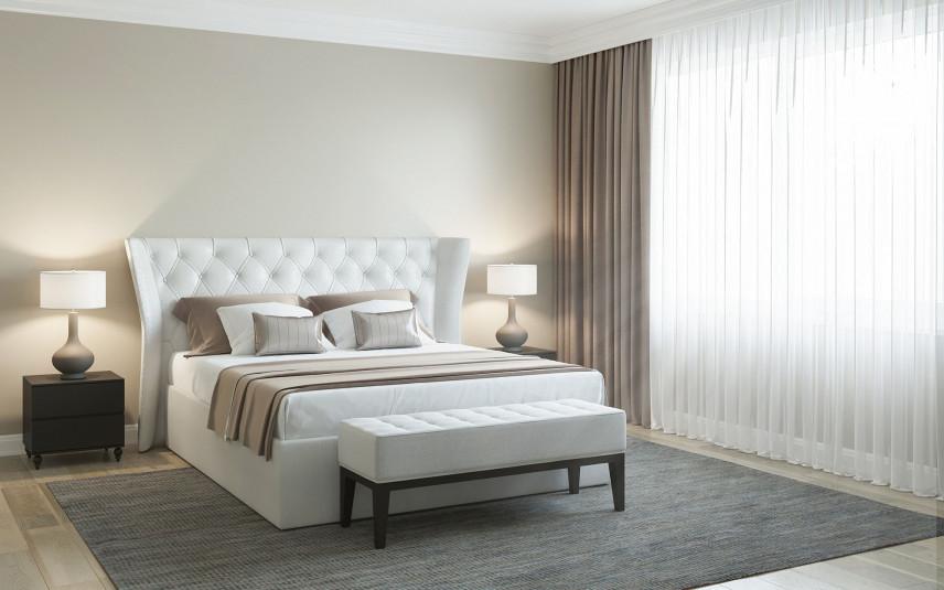 Łóżko z białym zagłówkiem