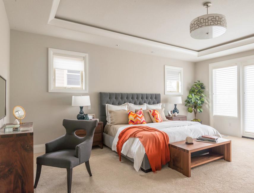 Sypialnia z szarymi ścianami