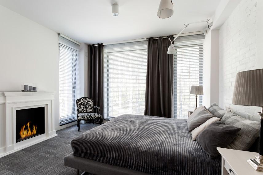 Klasyczna sypialnia z kominkiem