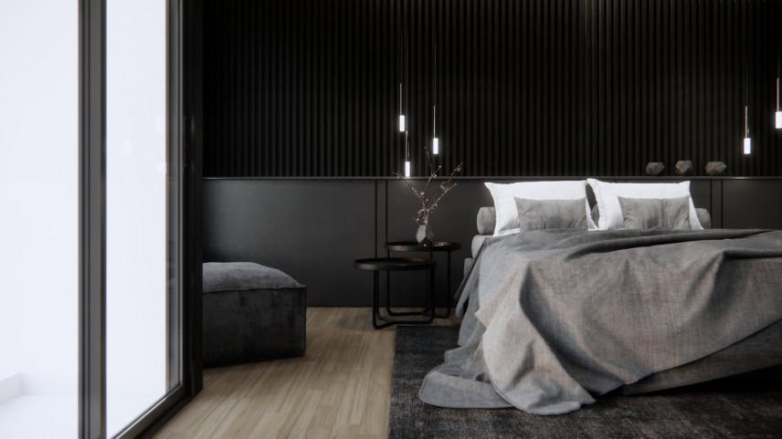 Aranżacja czarnej sypialni z balkonem