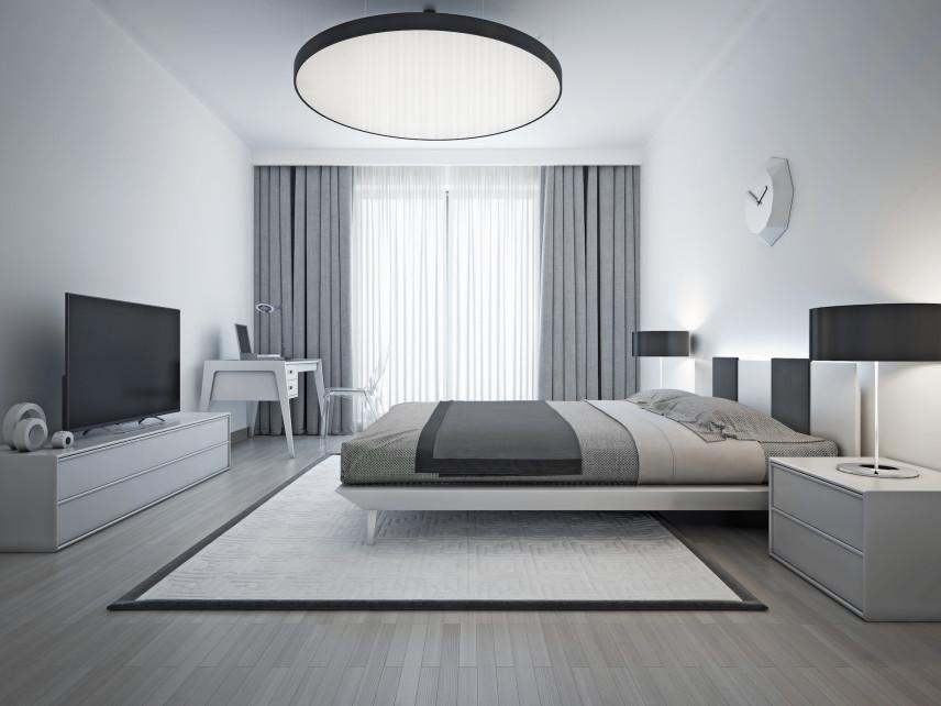 Designerska, okrągła lampa w sypialni