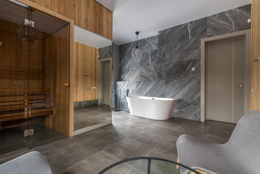 Aranżacja łazienki z owalną wanną