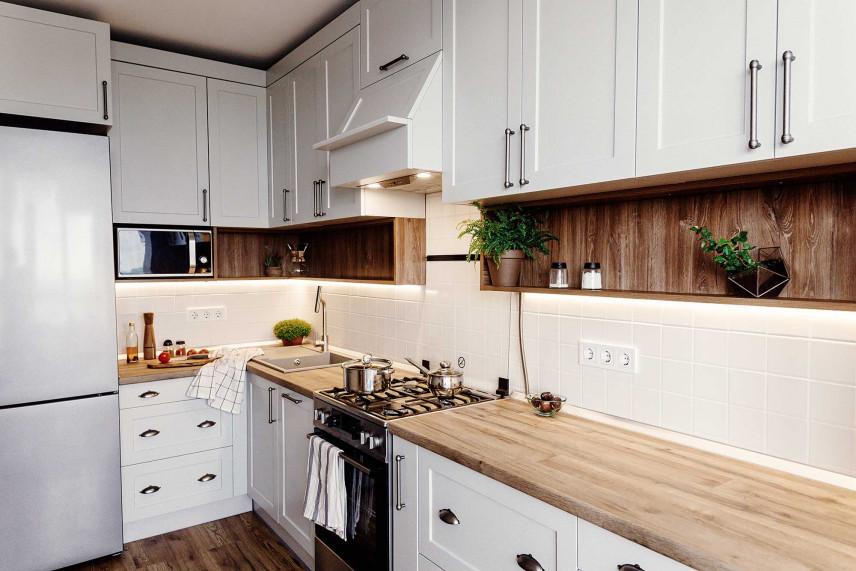 Mały aneks kuchenny z drewnianym blatem