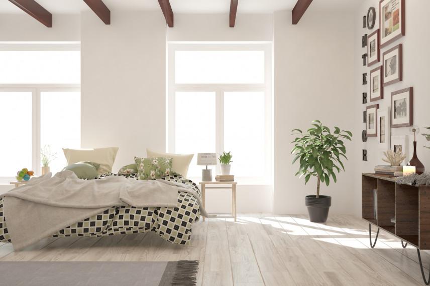 Stylowa sypialnia z dużą ilością zdjęć