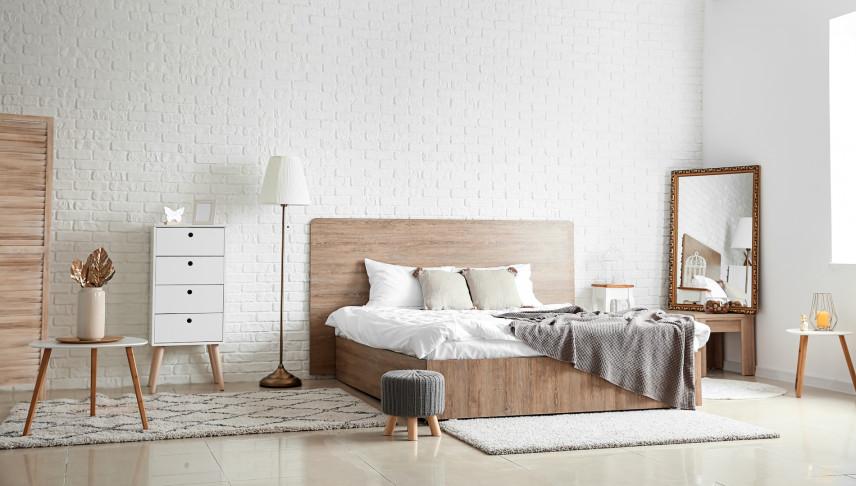 Retro sypialnia ze ściana z cegły