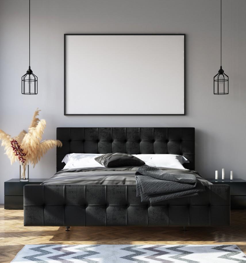 Duże, czarne, tapicerowane łóżko