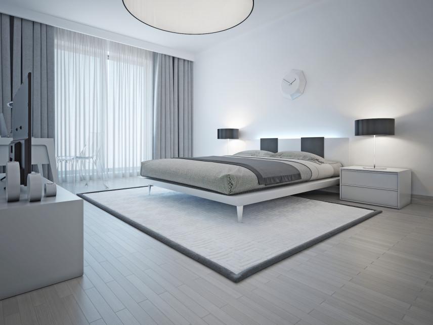 Nowoczesna sypialnia w designerska lampą