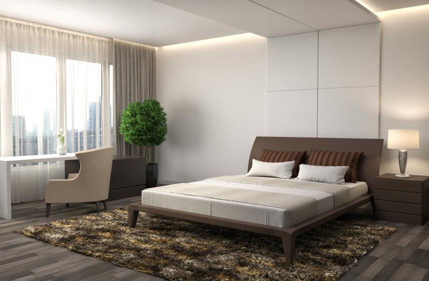 Biała sypialnia z ciemną podłogą