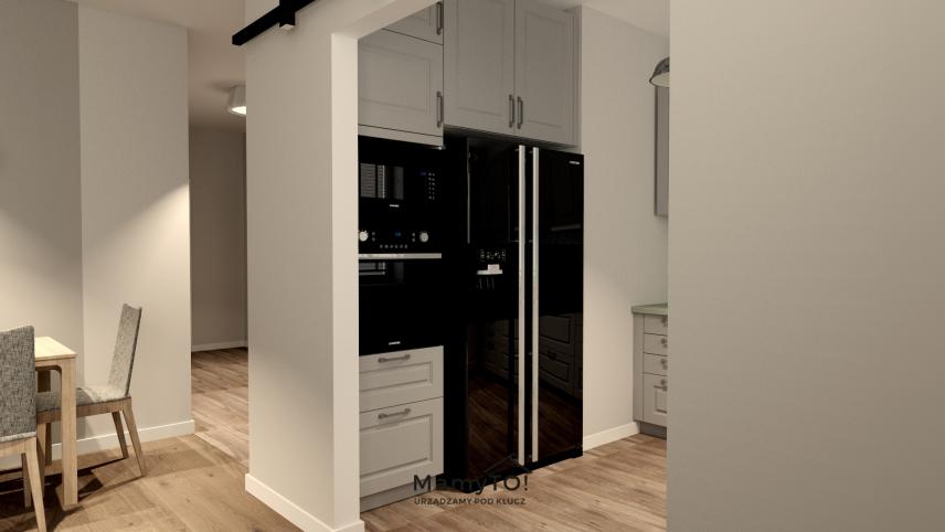 Mała, zabudowana kuchnia w mieszkaniu