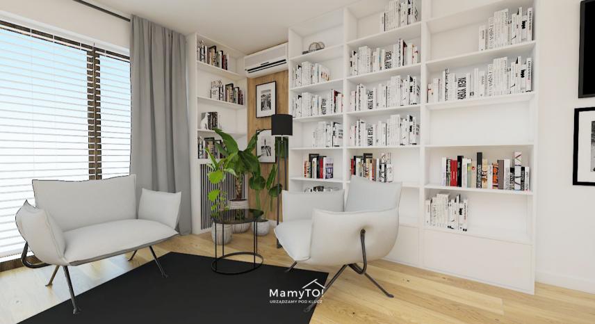 Salon z biblioteką na ścianie w kolorach bieli