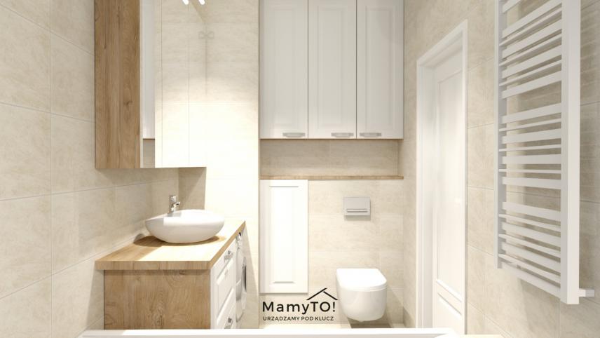 Wąska, mała łazienka z szafkami wiszącymi