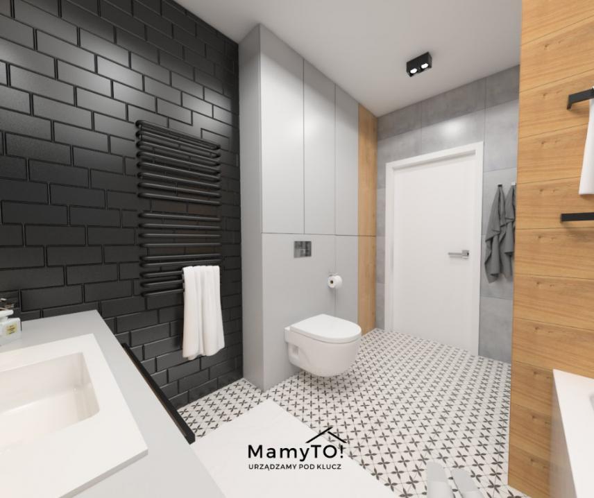 Czarne cegła na ścianie w łazience