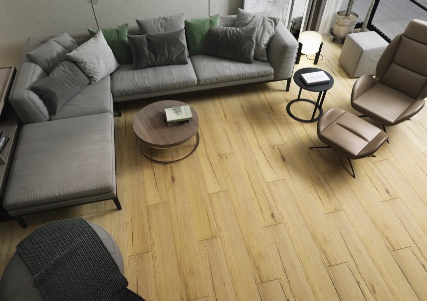 Salon z szarym narożnikiem i fotelem
