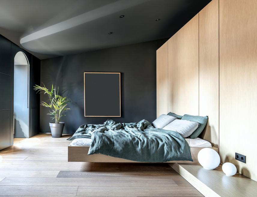 Nowoczesna sypialnia z ciemnoszarymi ścianami