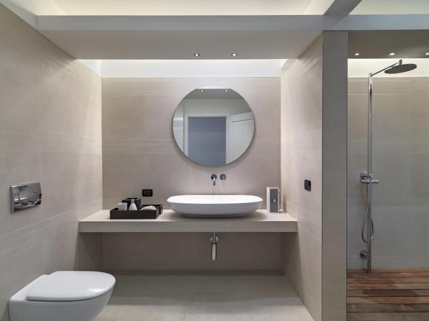 Aranżacja łazienki z okrągłym lustrem