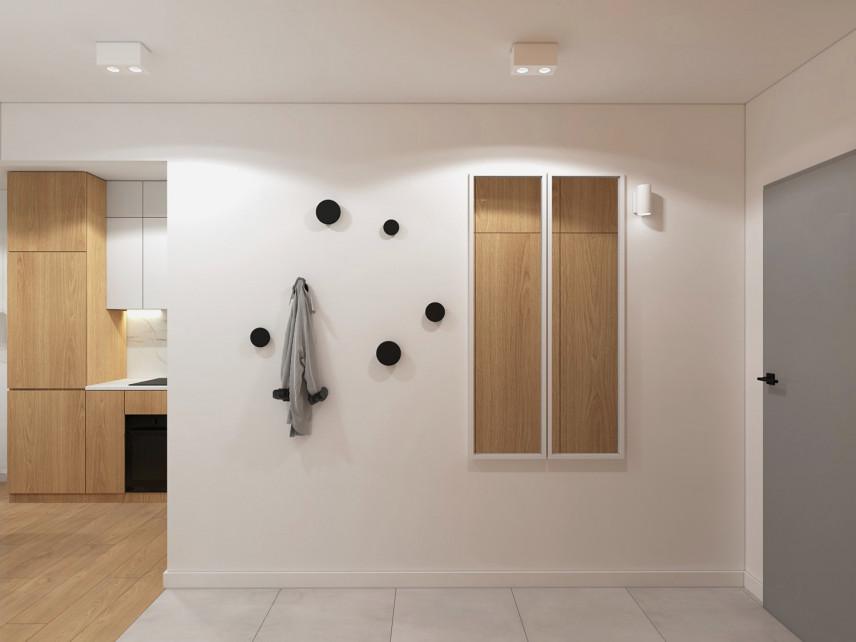 Przedpokój z elementami drewna na ścianie