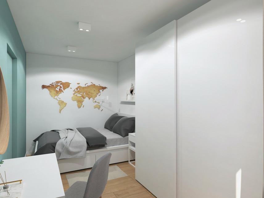 Mała sypialnia z mapą na ścianie