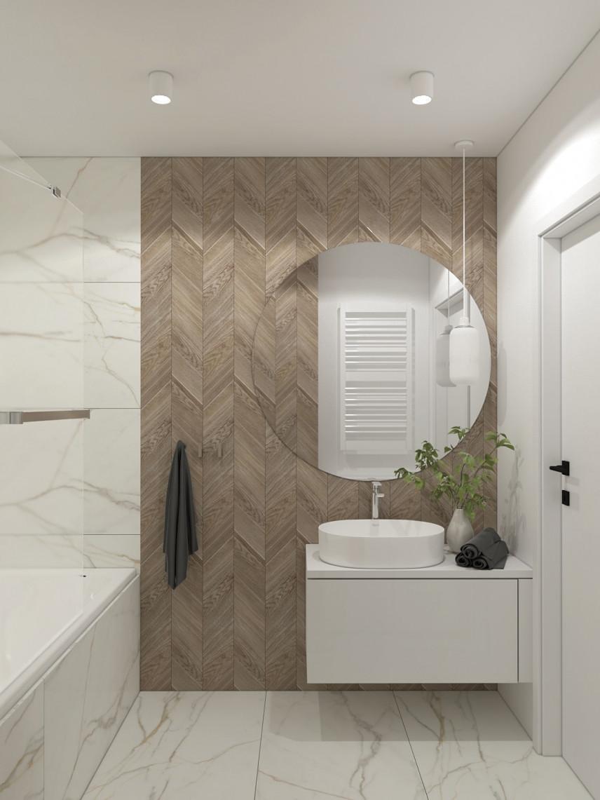 Łazienka z okrągłym lustrem i imitacją drewna na ścianie