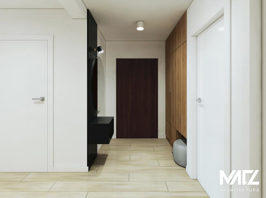Aranżacja korytarza z jasną podłogą