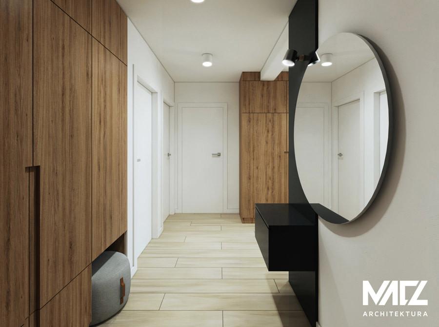 Stylowe lustro okrągłe w korytarzu