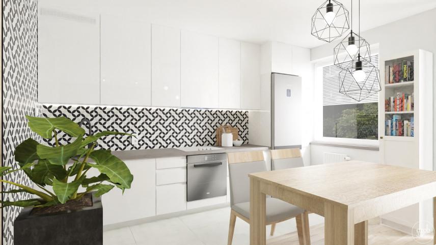 Aneks kuchenny z czarno-biała ścianą