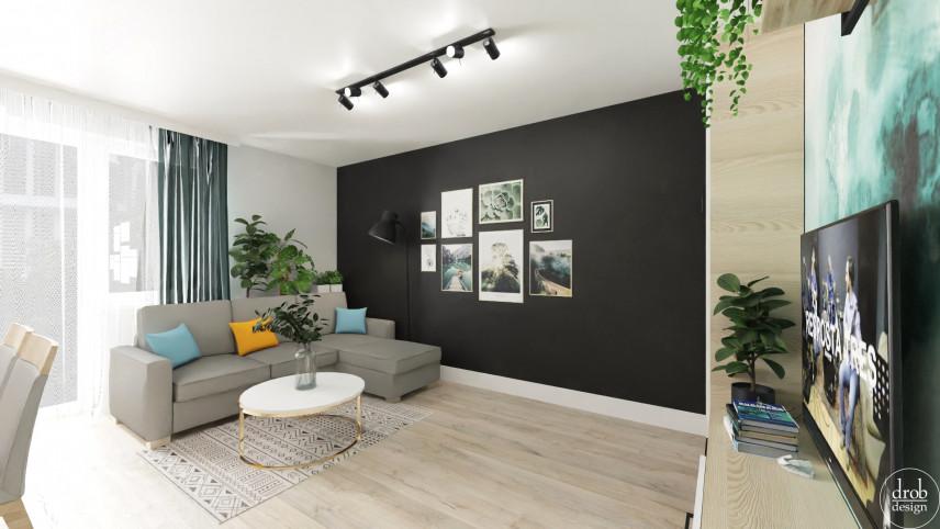 Salon w stylu loft z antracytową ścianą