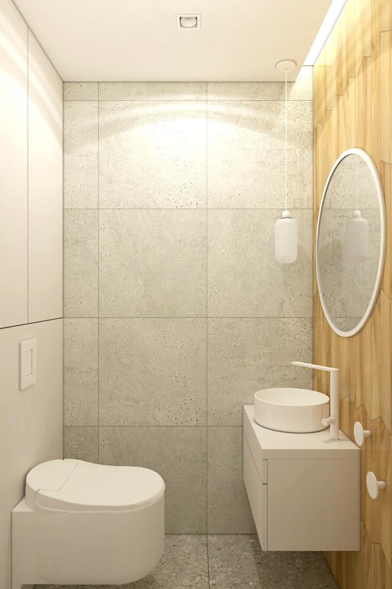 Aranżacja małej łazianki z dużymi, szarymi kaflami