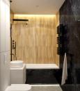 Stylowa łazienka z czarnym grzejnikiem