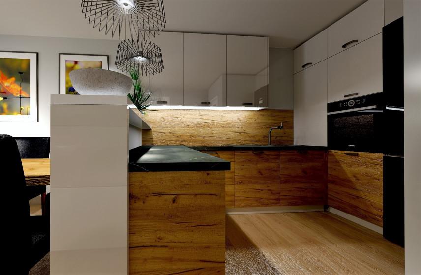 Mała kuchnia z drewnianą płytą nad blatem