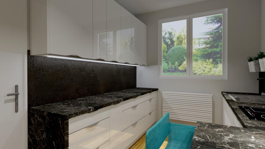 Aranżacja kuchni z czarną płytą nad blatem