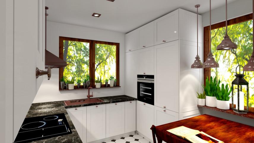 Białe fronty w kuchni z brązowymi klamkami