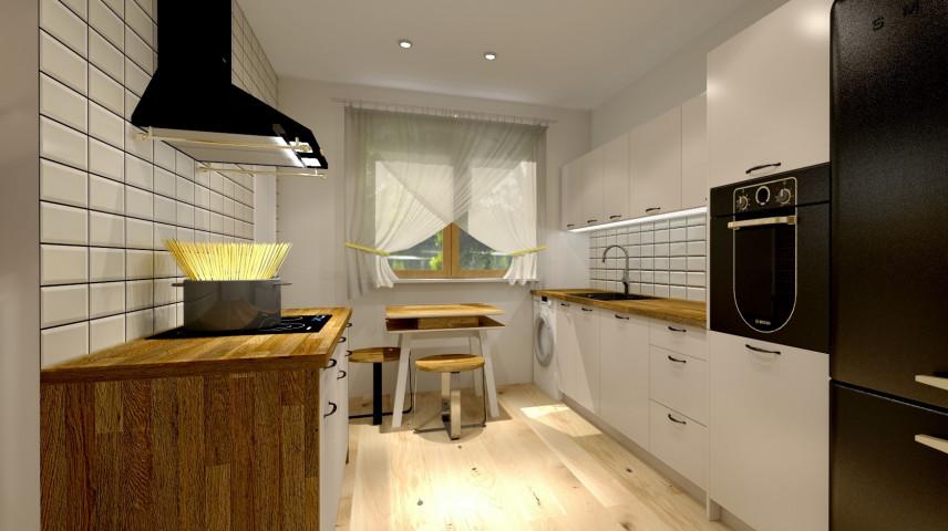 Projekt kuchni z płytą indukcyjną i czarnym okapem