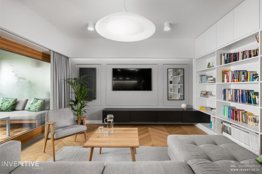 Salon w stylu skandynawskim z tapicerowanym narożnikiem