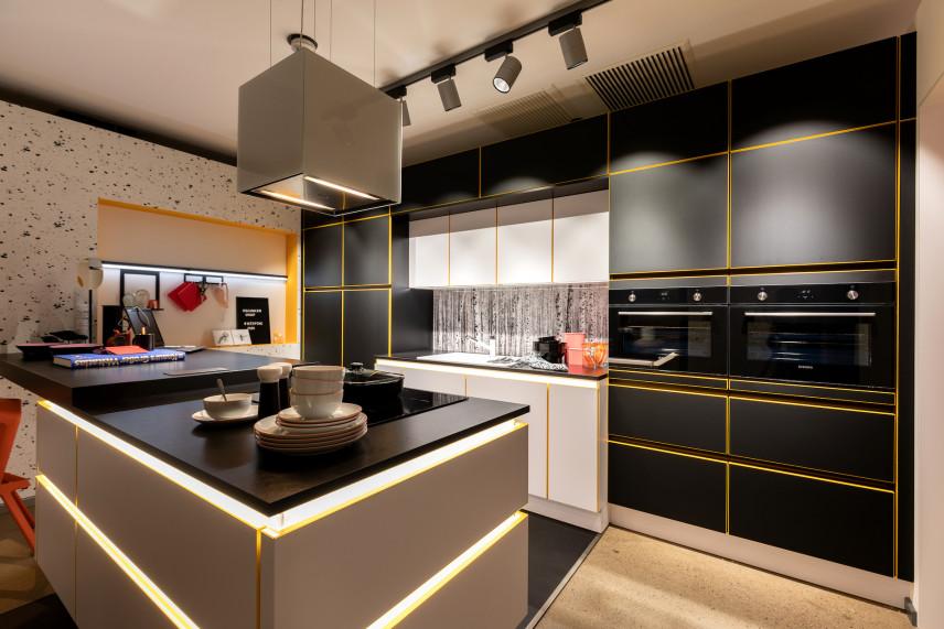 Designerska kuchnia z szaro-żółtymi frontami