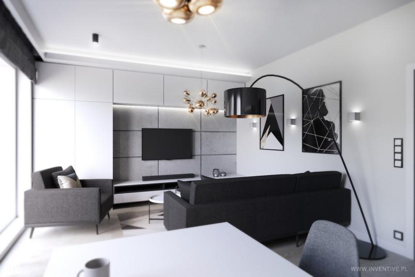 Nowoczesny, czarno-biały salon ze stylową lampą