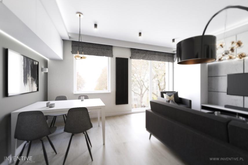 Salon w kolorze czarno-białym z telewizorem