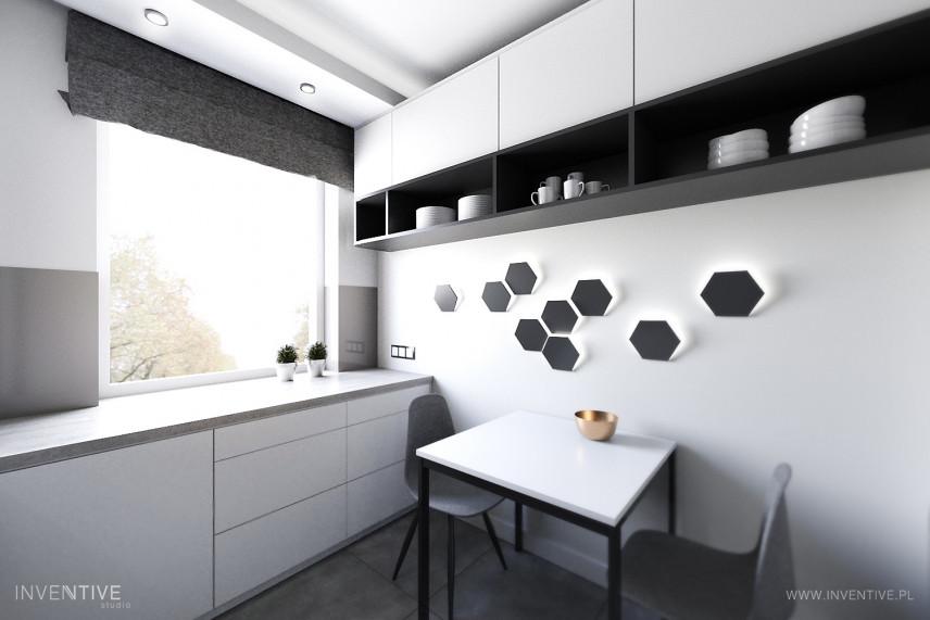 Minimalistyczna kuchnia w kolorze grafitowo-białym