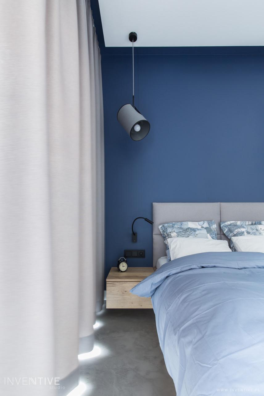 Designerska lampa wisząca w sypialni